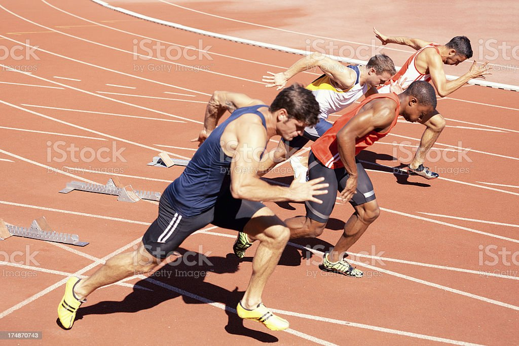 100 meter sprinters out of starting blocks stock photo
