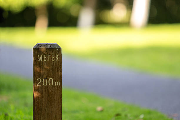 meter stake beside greenway in park stock photo