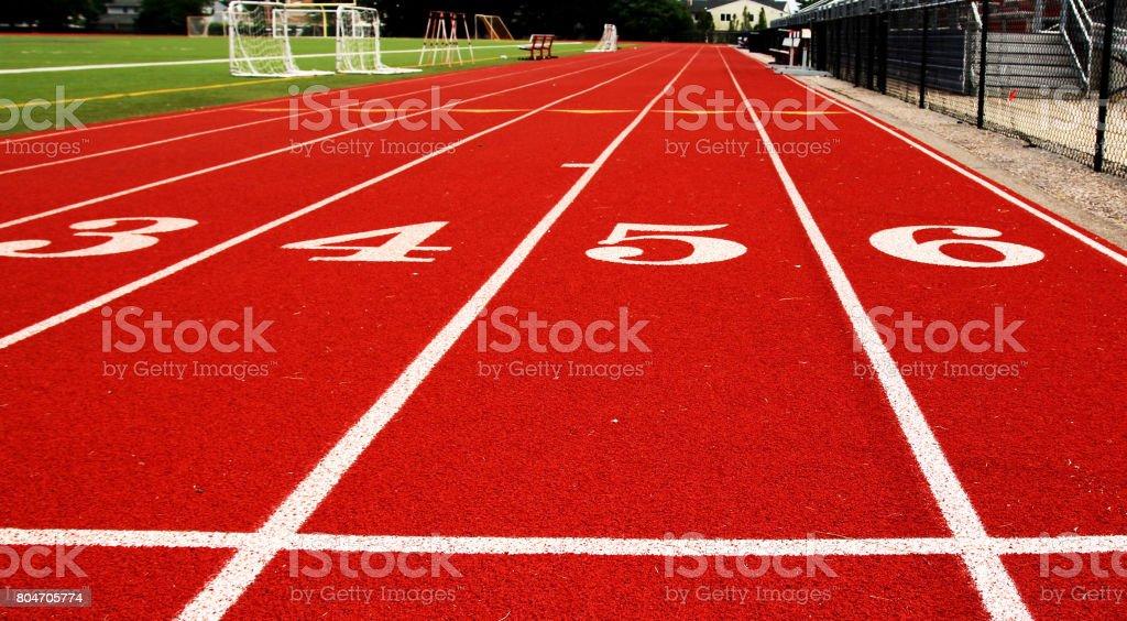 100 meter start line in track stock photo