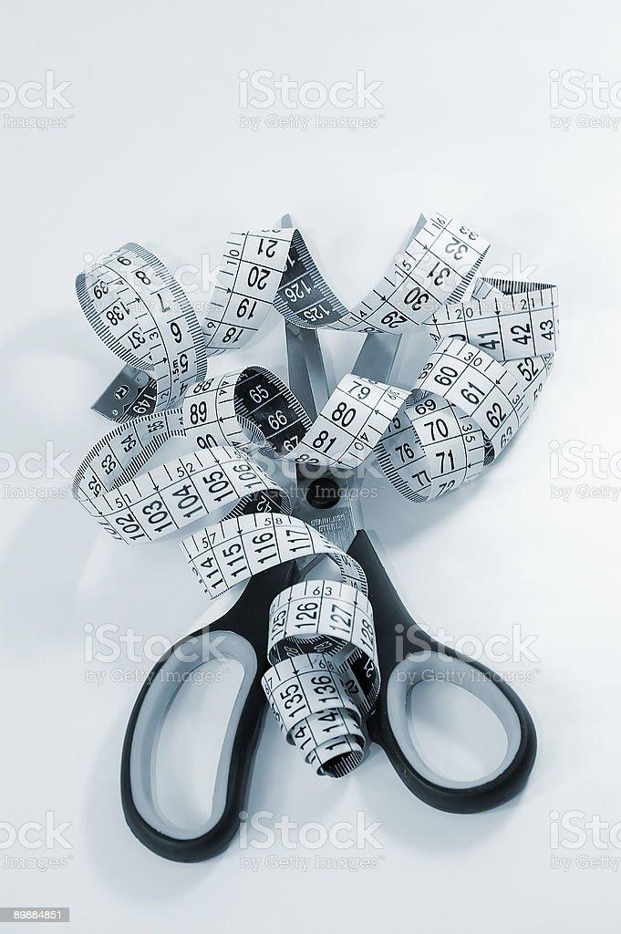 Meter studio and cutting scissors royalty-free stock photo