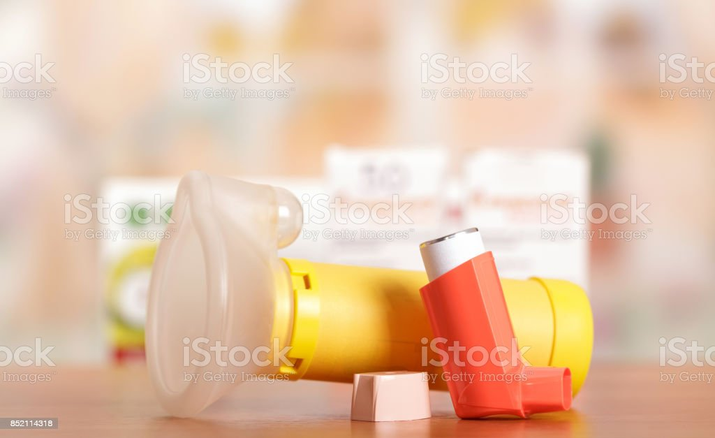Metered dose inhaler with a mask stock photo
