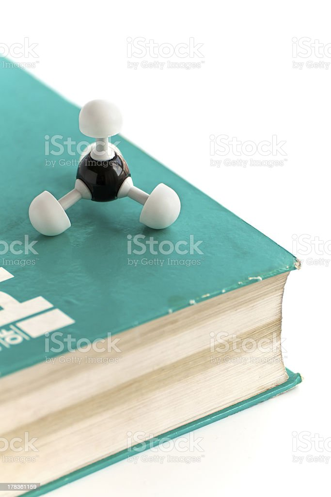 Methane molecule on old science book stock photo