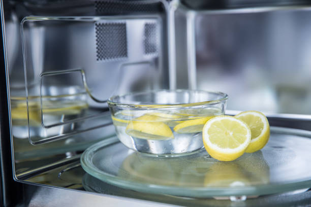 A method of cleaning in a microwave oven with water and lemon stock photo