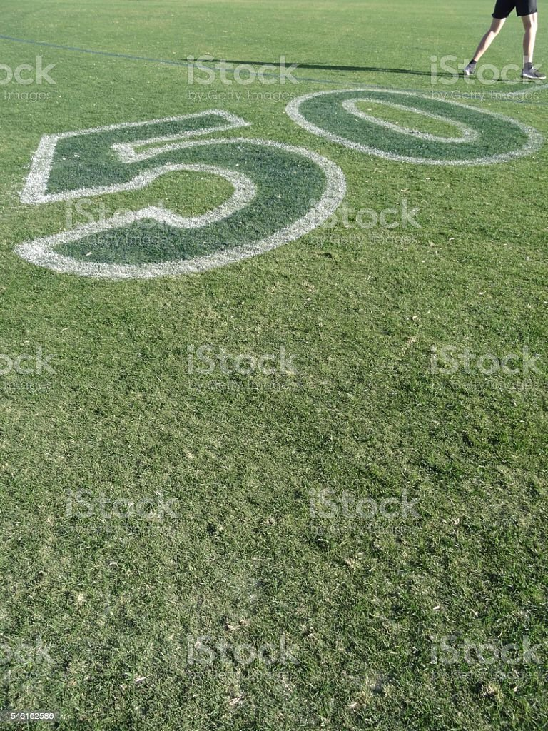 50 metre line in football -man playing football in corner stock photo