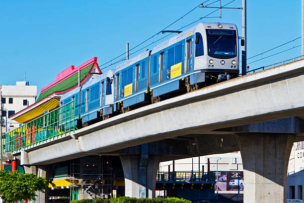 """Metro Gold Line Train Depart Chinatown Station """"Los Angeles, USA - June 30, 2011: The Metro Gold Line train bound for Sierra Madre Villa station and east Los Angeles County departs the Chinatown Station."""" depart stock pictures, royalty-free photos & images"""