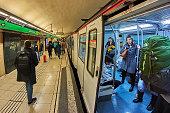 Barcelona, Spain - December 27, 2019: Passengers at a metro station in Barcelona.
