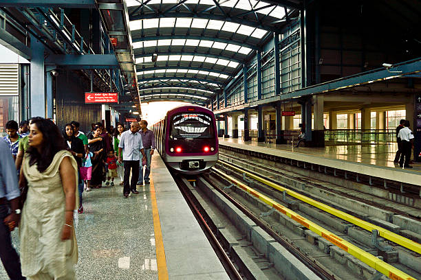 metro railwaystation in bangalore Bangalore, India - November 4, 2012: Bangaloreans using new mode of transportation system at MG road metro railwaystation bangalore stock pictures, royalty-free photos & images