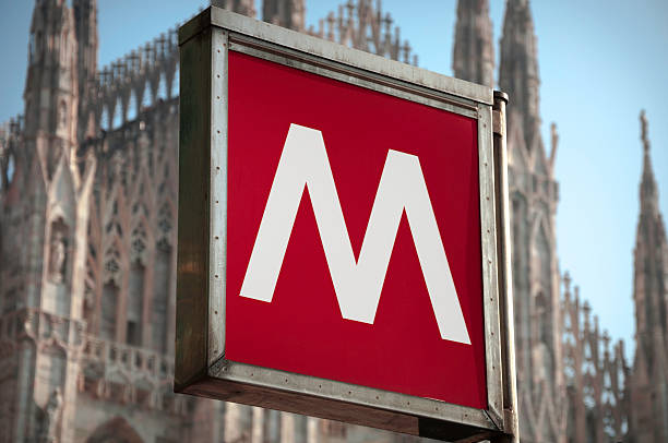 metro sign and the milan chatedral - milan railway foto e immagini stock