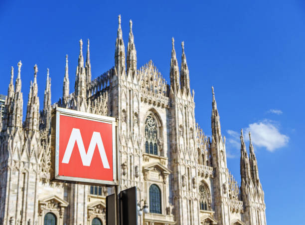 metro sign at milan cathedral - milan railway foto e immagini stock