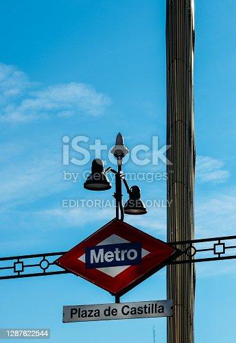 Madrid, Spain - Nov 21, 2020: Metro sign with golden monolith in Plaza de Castilla, Madrid, Spain