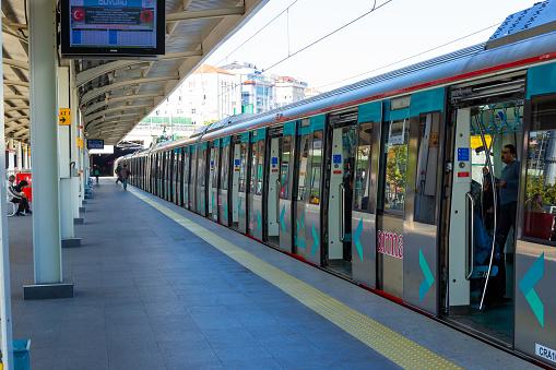 Istanbul, Turkey - October 10, 2019: Marmaray train with open doors on outdoor metro station in Istanbul, Turkey.