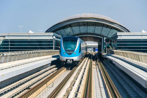 Metro tracks and Metro to downtown Dubai - UAE stock photo