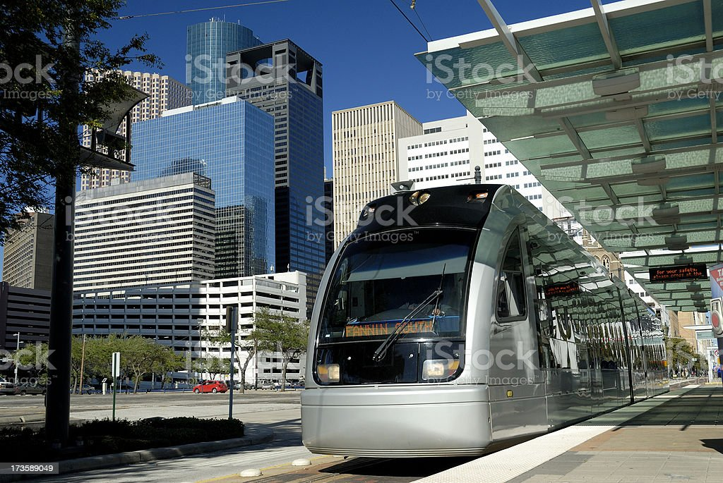 Metro Train at Platform With Modern Skyscrapers In Background royalty-free stock photo