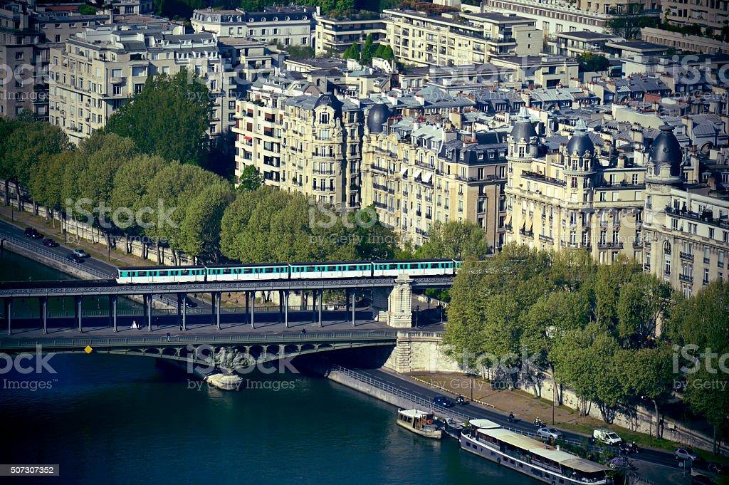 Metro train crossing Passy Bridge over the Seine River stock photo