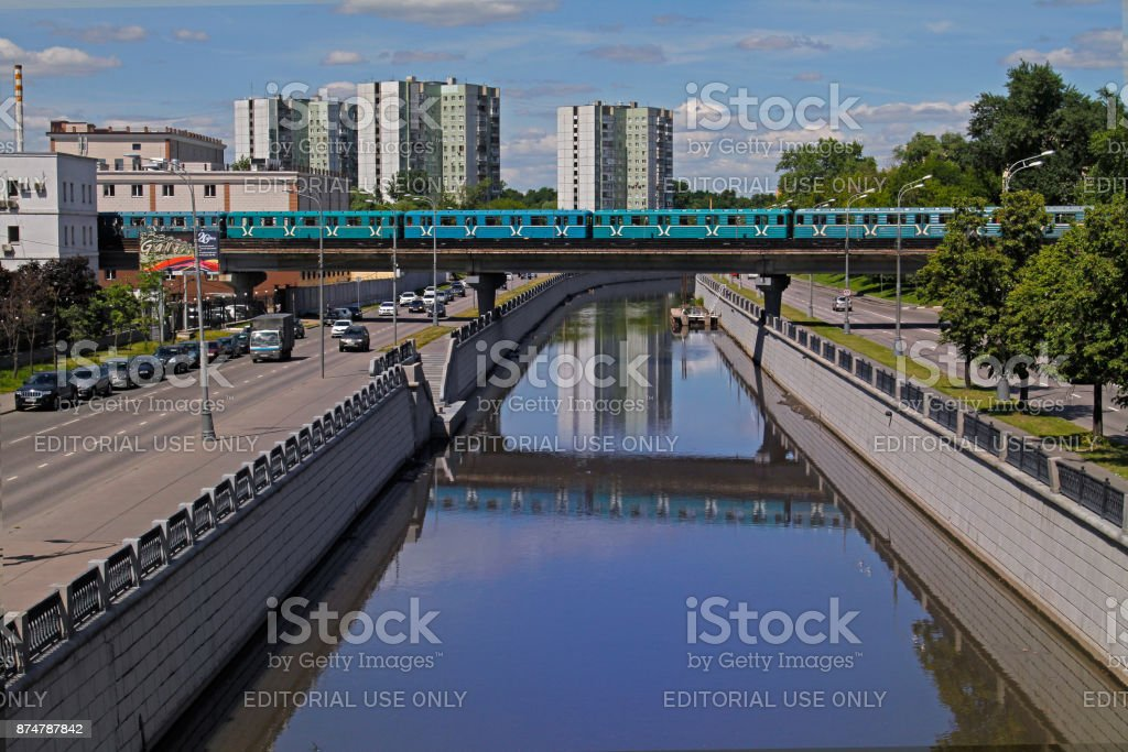 Metro (underground) train goes by Preobrazhenskiy bridge on Yauza river in Moscow stock photo