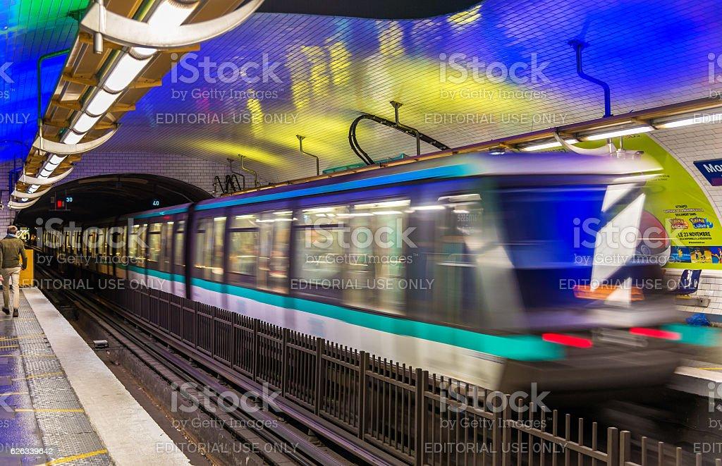 Metro train leaving Montparnasse - Bienvenue station in Paris, France stock photo