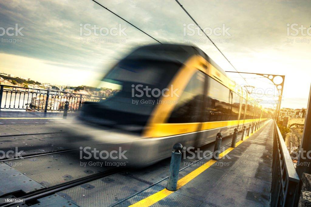 Metro train passes on a long suspended bridge stock photo