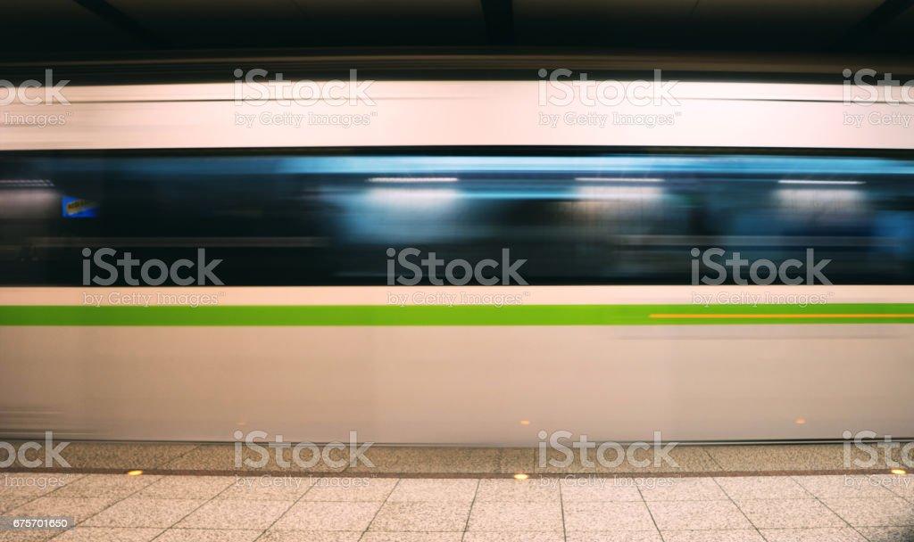 Metro train speeding up in the subway royalty-free stock photo