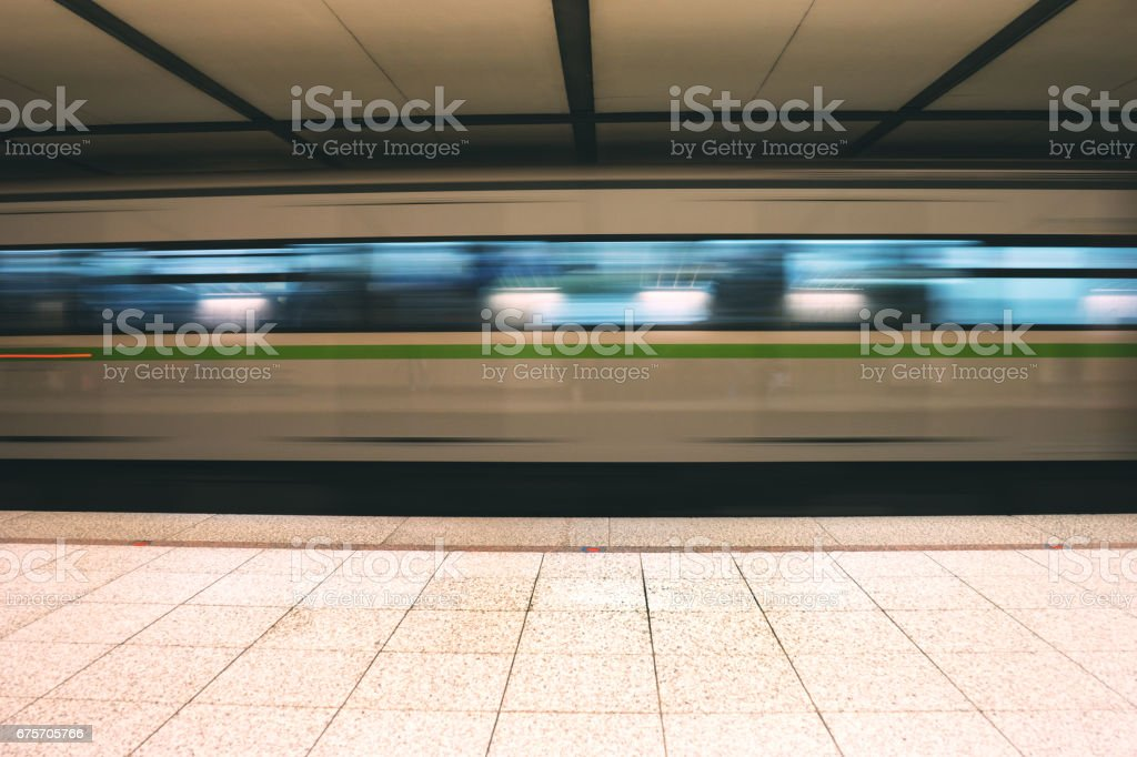 Metro train speeding up in the subway 免版稅 stock photo