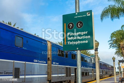 Fullerton, CA / USA – May 25, 2019: Metrolink sign and the Amtrak Surfliner at the Fullerton Train Station.