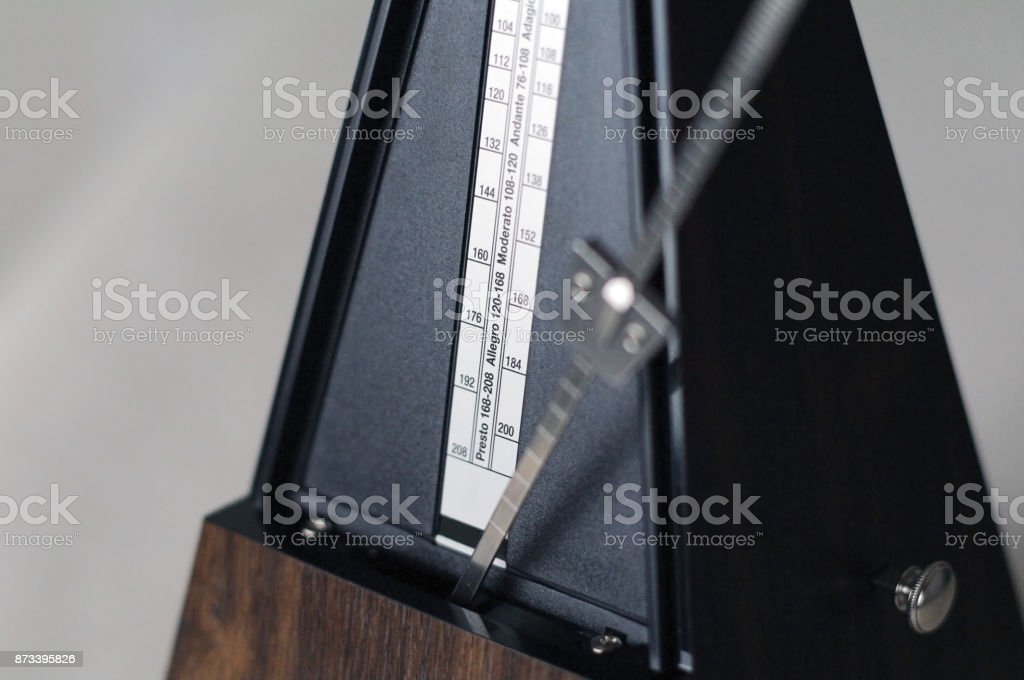 Metronome closeup in action isolated and on a plain background stock photo
