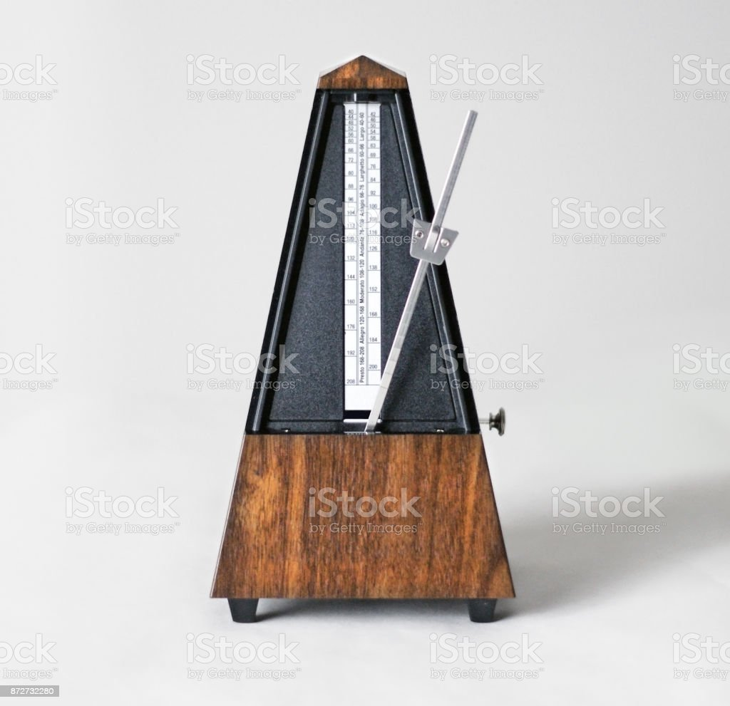 Metronome in action, closeup, isolated and on a plain background stock photo
