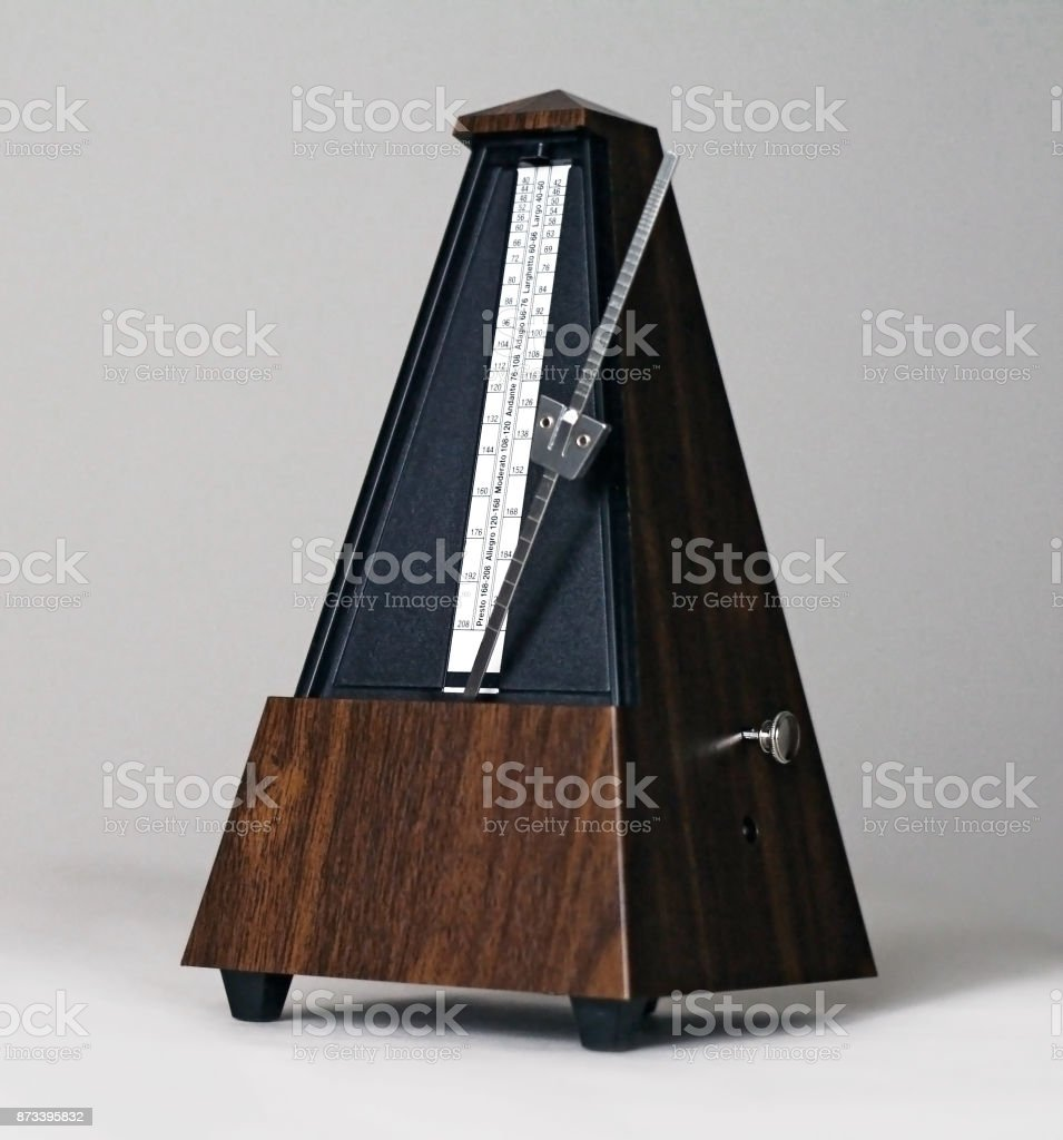 Metronome in action isolated and on a plain background stock photo