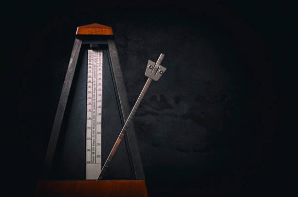 metronome - pendulum stock photos and pictures