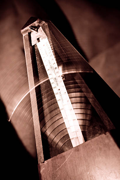 metronome with motion blur, sepia toned - perpetual motion stock photos and pictures
