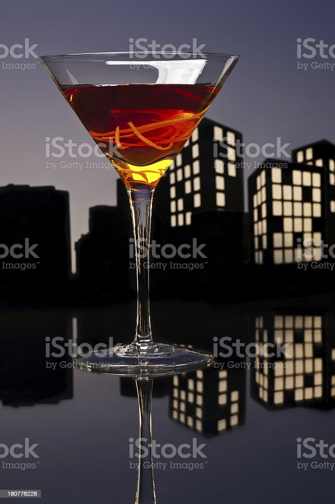 Metropolis Manhattan cocktail in city skyline setting stock photo
