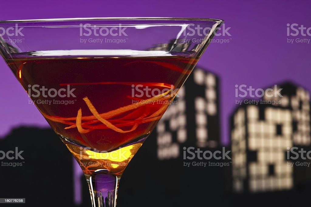 Metropolis Manhattan cocktail in city skyline setting royalty-free stock photo