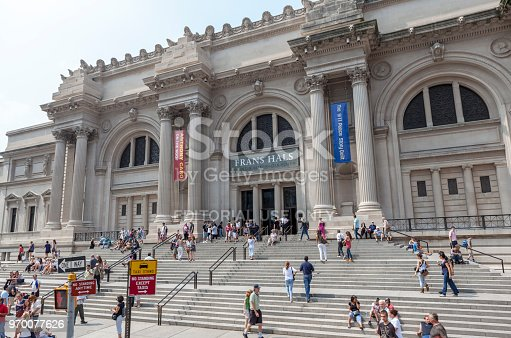 New York City, USA - September 4, 2011: People sitting and walking in front of the Metropolitan Museum of Art in New York City. The museum is located on Fifth Avenue in Upper East Side and is one of the most celebrated museums in the world