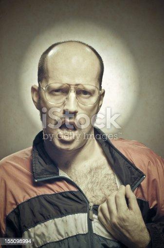 Metrosexual retro guy showing off hairy chest.http://www.phototrolley.com/downloads/BannersIstock/BannerBizarre.jpg
