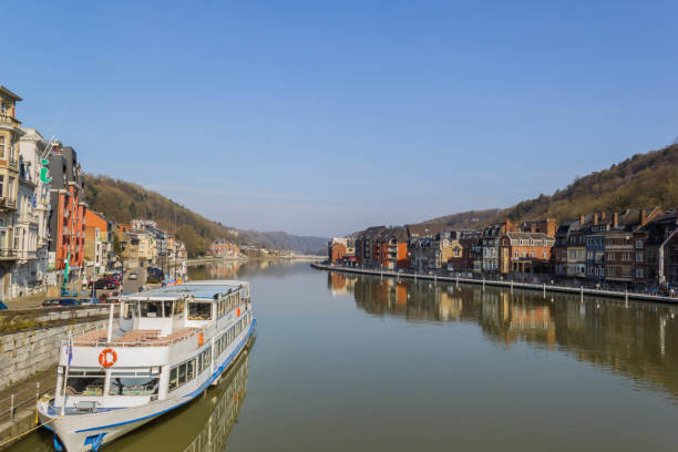 Meuse river at Dinant DINANT, BELGIUM - MARCH 25 2018: Meuse river bank on March 25,2018 in Dinant, Belgium meuse river stock pictures, royalty-free photos & images