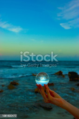 A beautiful Caribbean beach on the Yucatan peninsular in Mexico at Tulum, seen through a crystal sphere.