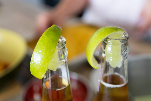 Mexican beer with lime closeup stock photo