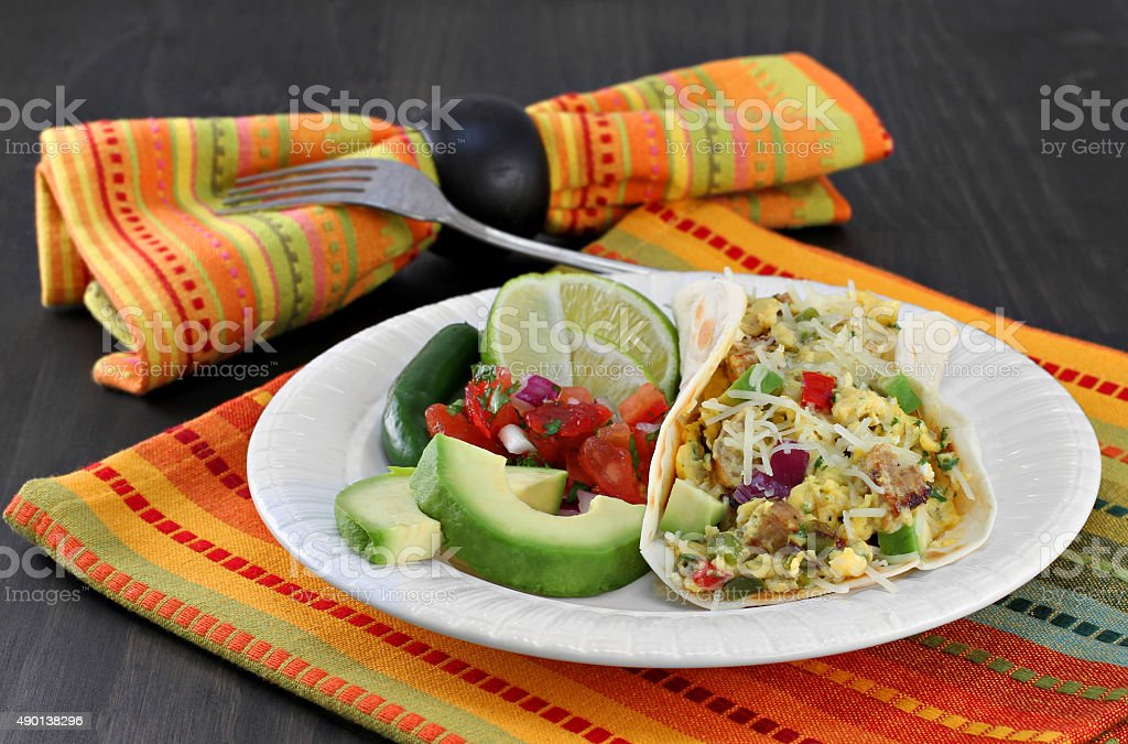 Mexican breakfast egg and chorizo taco with pico de gallo. stock photo