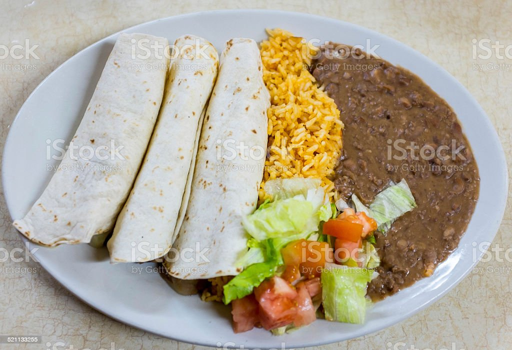 Mexican Burrito Rice Beans and Salad stock photo