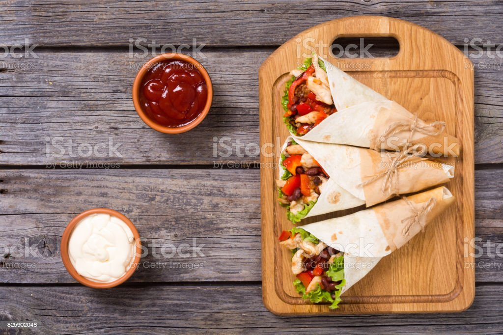 Mexican burrito with chicken stock photo