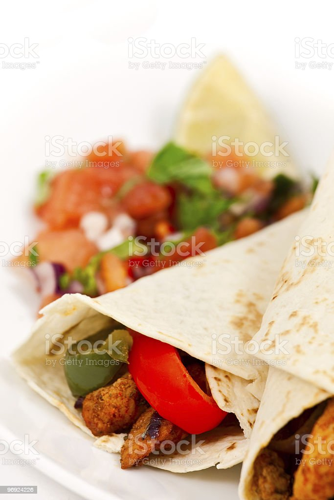 Mexican chicken fajita wraps with peppers and salsa royalty-free stock photo