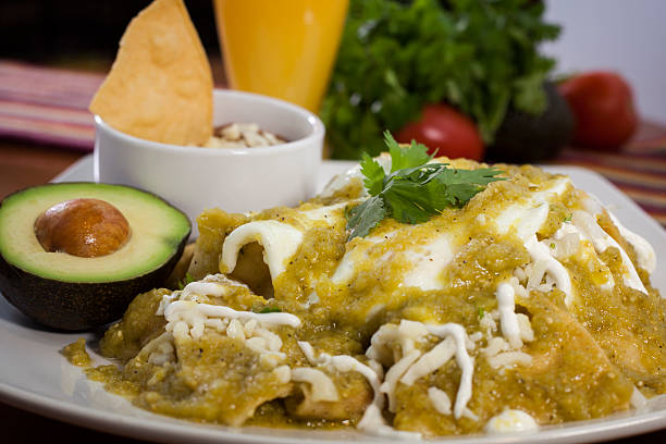 mexican chilaquiles dish - green chilli pepper stock photos and pictures