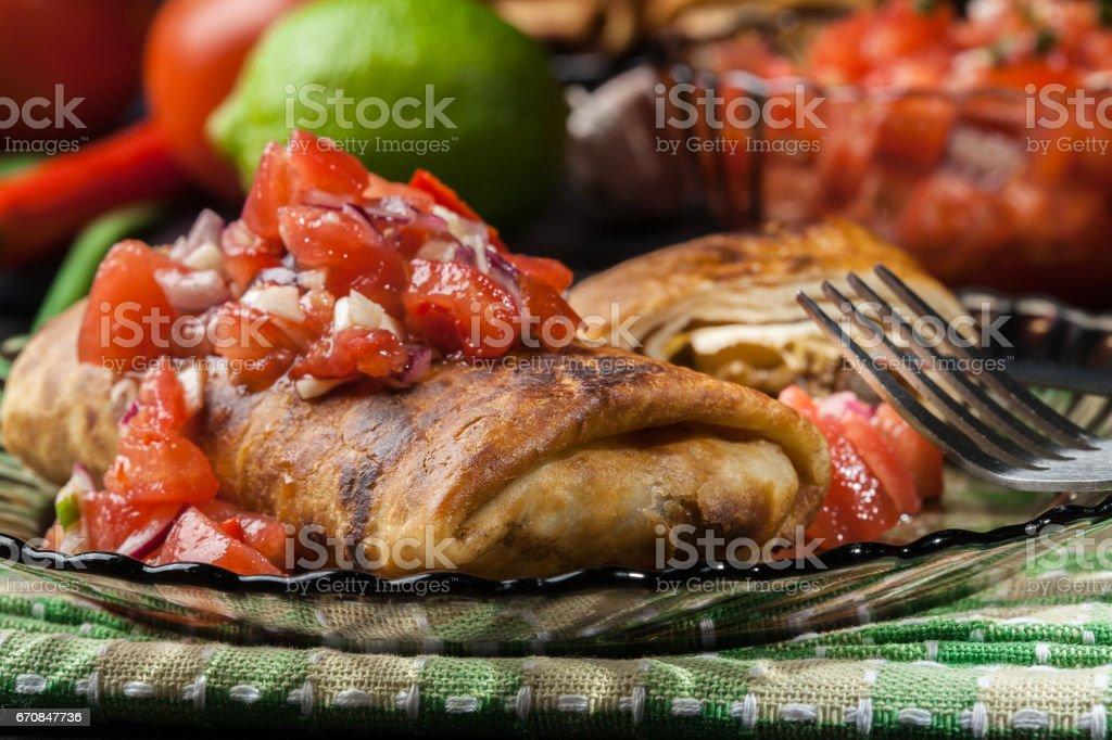 Mexican chimichanga with salsa dip stock photo