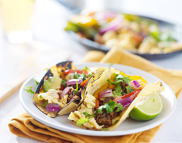 mexican chorizo scrambled eggs tacos stock photo