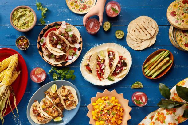 mexican cinco de mayo feast - cinco de mayo stock photos and pictures