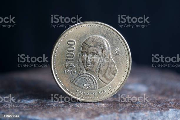 Mexican coin 1000 pesos of 1989, currency over wood texture.