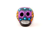 Mexican colorful skull in middle of white background
