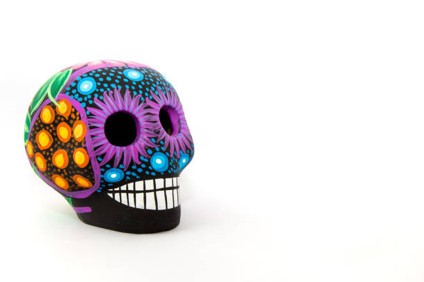Mexican colorful skull with white background A Mexican black and neon colors skull, with a white background craft product stock pictures, royalty-free photos & images