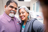 A senior mexican couple take a selfie after casting their vote