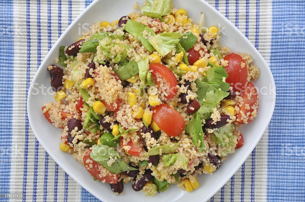 Mexican Couscous Salad with tomatoes, corn and beans royalty-free stock photo