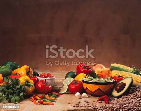 A group of Mexican Cuisine raw ingredients, guacamole and salsa. Farm fresh and organic food.